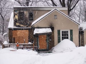 Aftermath of House burned in fire in winter.
